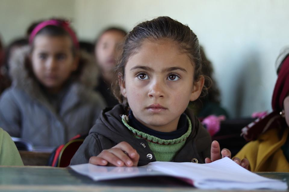 Children like 7-year-old Nour who have enrolled in the Self-Learning Program receive school bags, school supplies textbooks and mine risk education sessions.