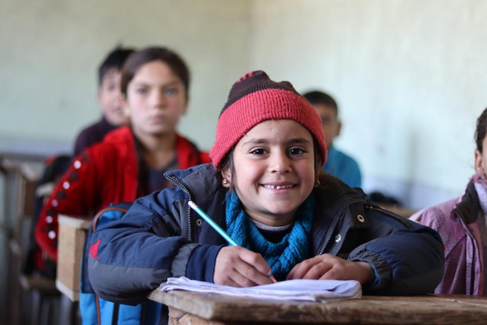 In Qaramel village, 14 miles north of Aleppo, Educate a Child and UNICEF's Self-Learning Program helps 230 children — including Sana, 6 (above) — from nine neighboring villages.