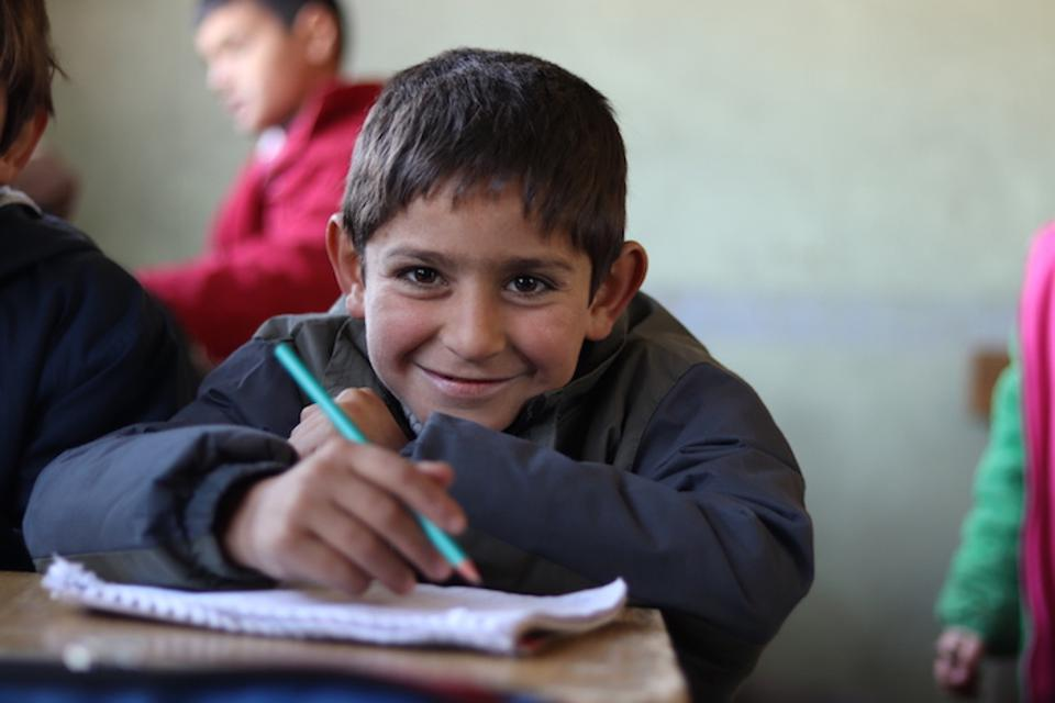 It's chilly inside the school building, but 7-year-old Ali (above) is happy to be back in a classroom. He's one of the more than 2 million Syrian children whose education has been disrupted by the civil war.
