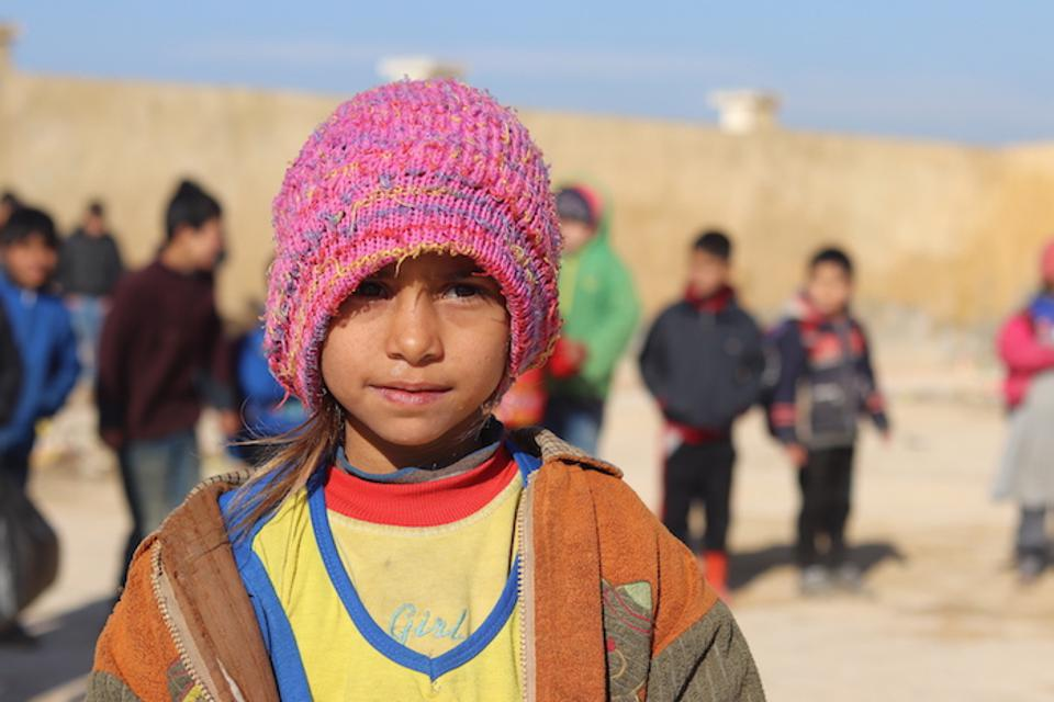 Seven-year-old Maryam is happy to be learning again, with help from Educate a Child and UNICEF.