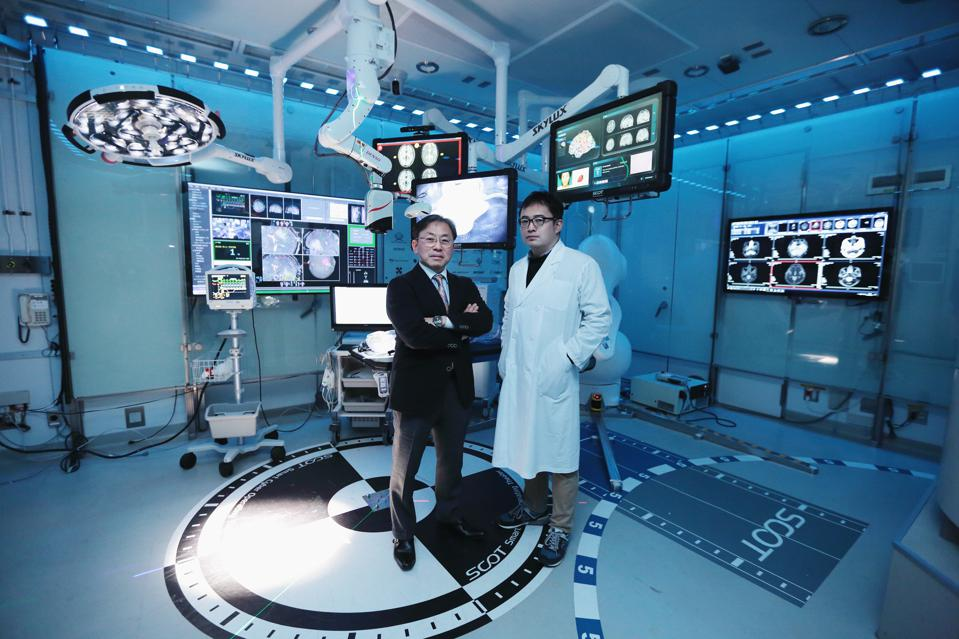 Yoshihiro Muragaki (left) and Jun Okamoto (right) of Tokyo Women's University's Institute of Advanced Biomedical Engineering and Science