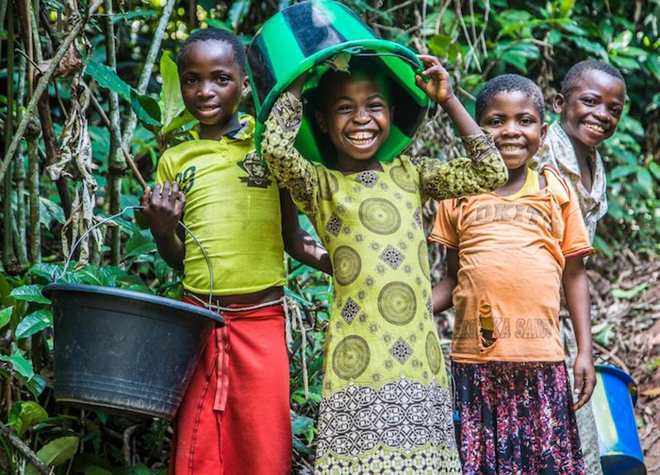 Children clown around while collecting water at a pumping and water distribution center built by UNICEF near Kananga, Kasai-Occidental province in the Democratic Republic of the Congo.