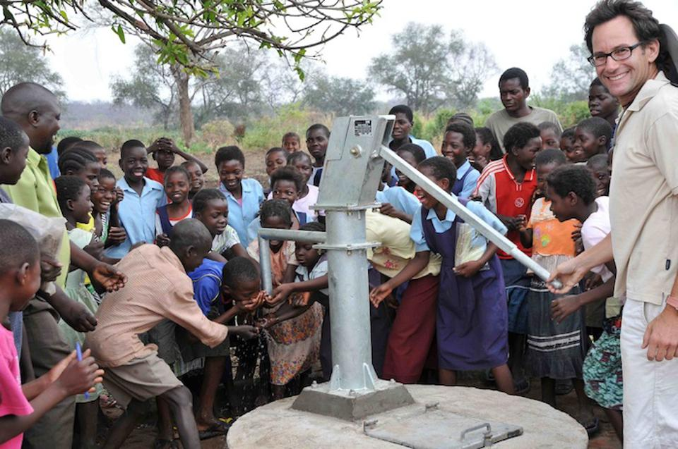 UNICEF USA Humanitarian Circle member Andy Astrachan joins children utilizing the well he helped to revive in Zambia.