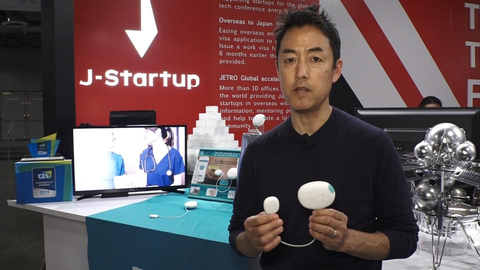 Ty Takayanagi, VP of Marketing at Triple W, demonstrates the company's DFree device, which helps people with incontinence issues monitor their bladder.