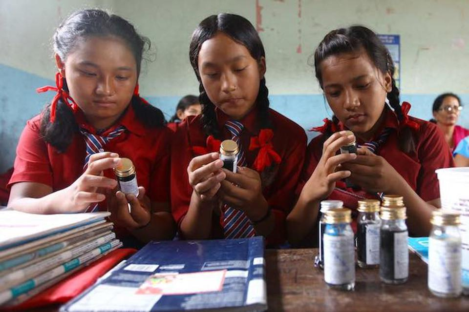 Thanks to cholera testing kits and training provided by UNICEF, these students in Nepal learned how to test the water quality after cholera broke out in their Kathmandu community.