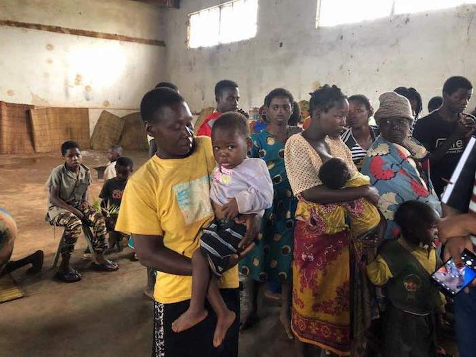 Angelina Paulo stood in line to get health care for her feverish 3-year-old son, António. Upon examination, doctors discovered he is suffering from malaria and severe acute malnutrition.