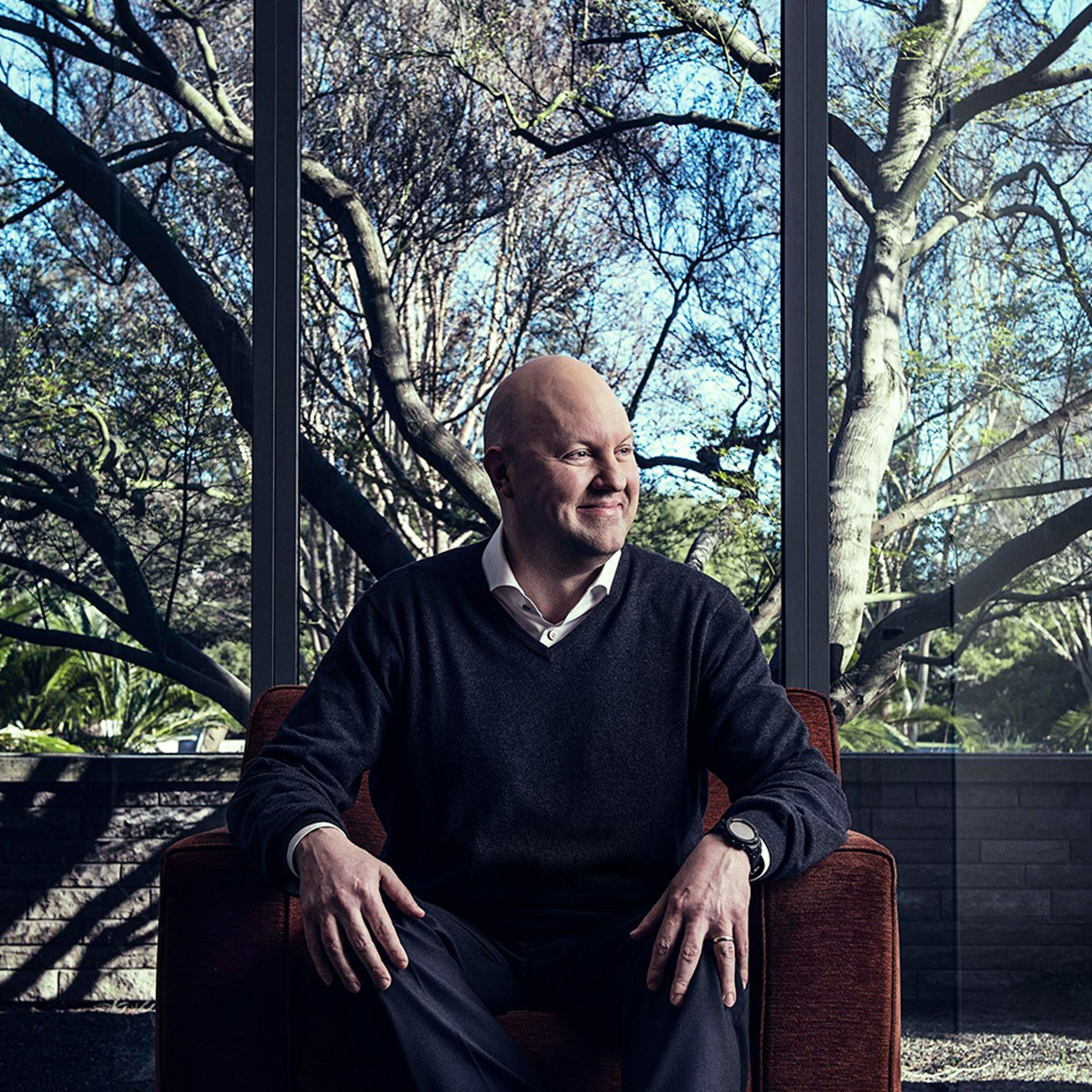 Marc Andreessen of Andreessen Horowitz seated in front of a window.