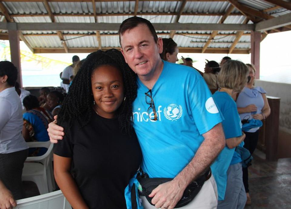 At a community meeting in La Ceiba, Honduras, UNICEF USA Chief Development Officer and Executive Vice President Barron Segar (right) met with young people like Andrea to discuss ways UNICEF can help them strengthen their community.