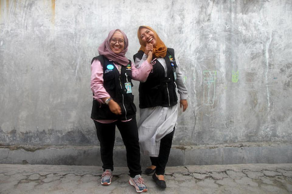 Social workers Kina Sidik (left) and Chi Ramadhani work as part of the UNICEF-supported family tracing and reunification program in Central Sulawesi.