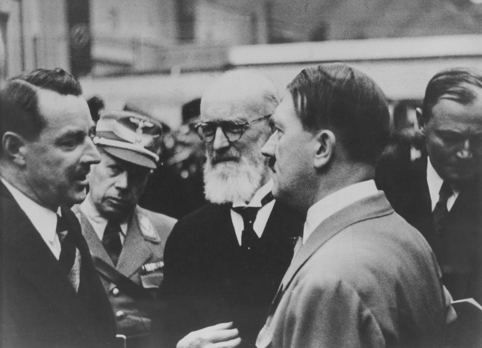 Robert Bosch (center) with Adolf Hitler (right). Despite supporting Jews throughout the war and opposing Hitler,