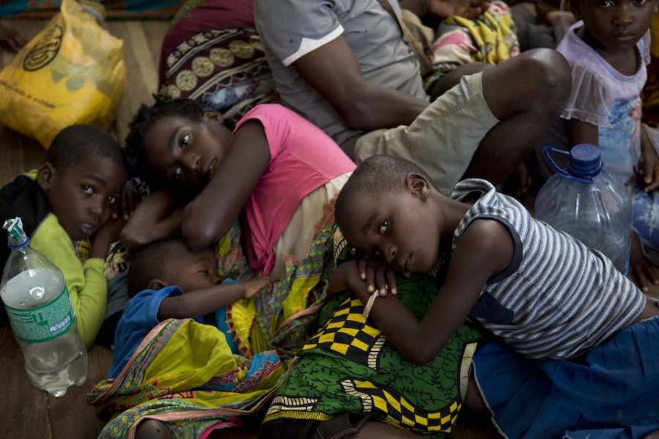 Displaced people rest at the Samora Machel school in Buzi Mozambique, where they took shelter after their homes were destroyed and flooded.