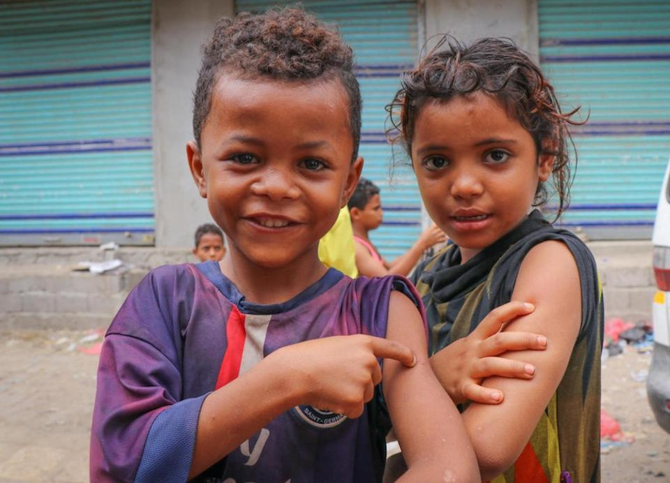 Children in Aden, Yemen proudly show off the spots on their arms where they were vaccinated during a mobile Measles and Rubella vaccination campaign backed by UNICEF in February 2019.