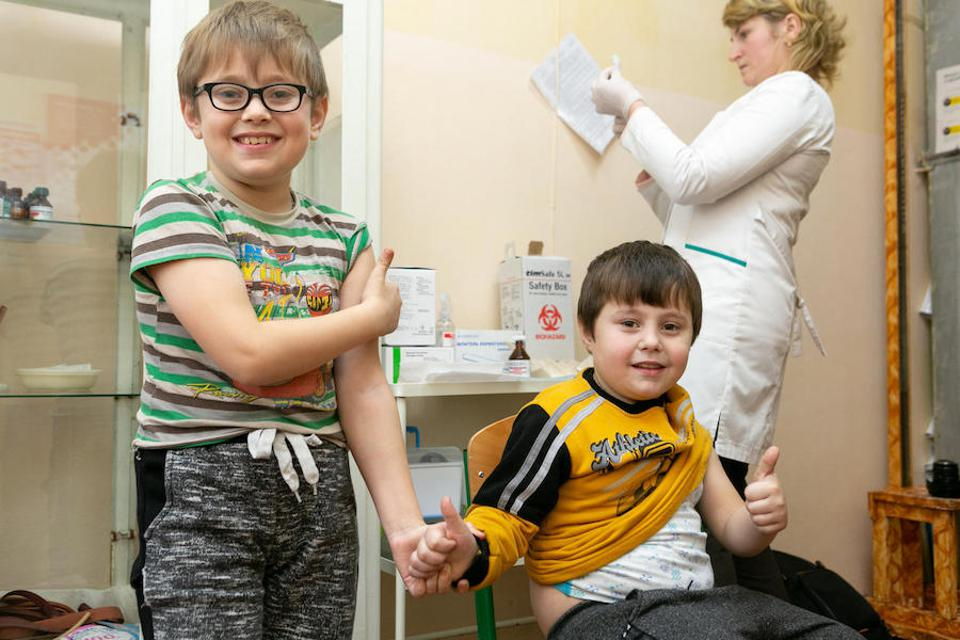 Liubomyr, 8, and his brother Bohdan, 6, hold hands after the school nurse gave them their measles, mumps and rubella vaccinations at Mykolaiv Gymnasium in western Ukraine's Lviv region in February 2019.