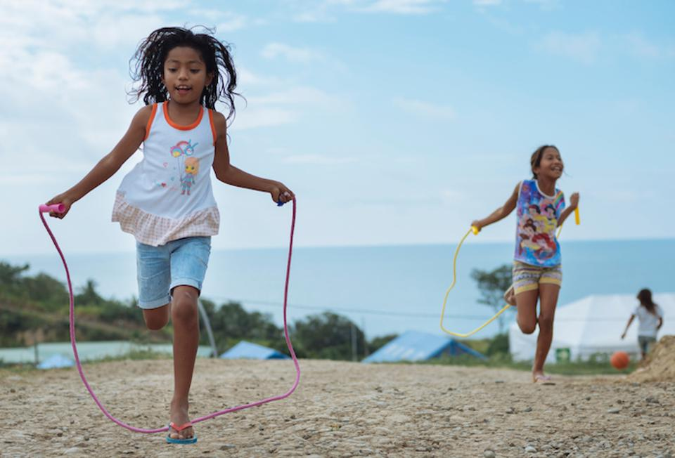 Girls jump rope at a UNICEF-supported Child-Friendly Space next to the Portete shelter in Esmeraldas, Ecuador.