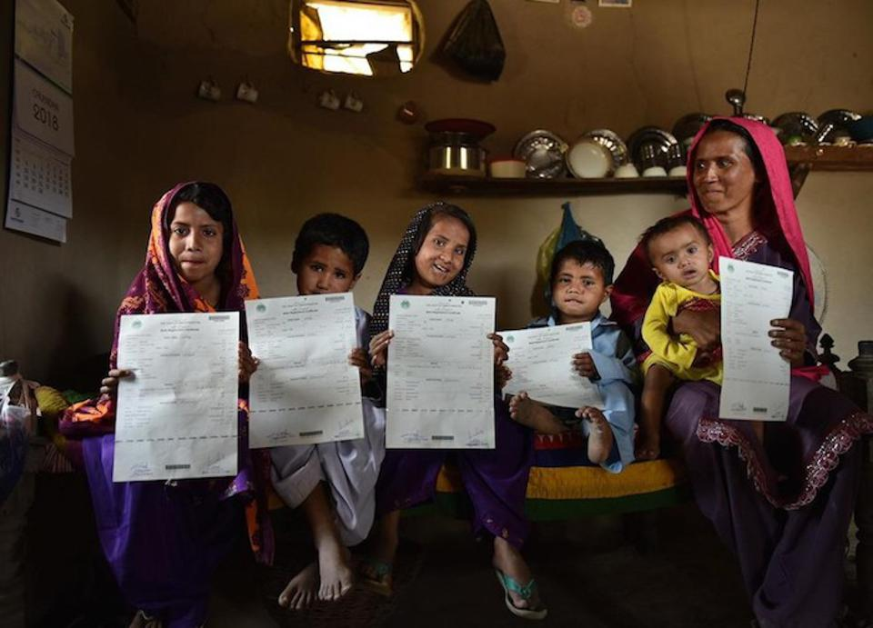 A mother in Pakistan with her five children: Bashira, 12, Shakeela, 8, Murtaza, 6, Sajan, 4, and Izra, 2, all recently registered and issued birth certificates using a new digital registration service launched by Telenor Pakistan in partnership with UNICEF.