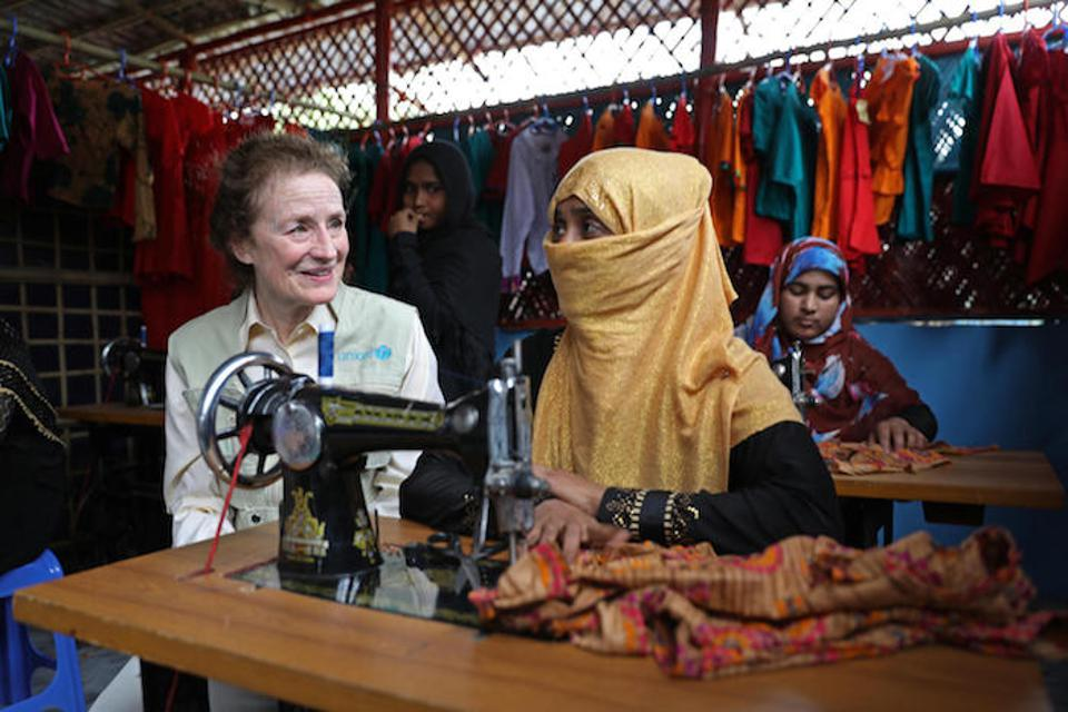 In February 2019 in Bangladesh, UNICEF Executive Director Henriette H. Fore receives a sewing lesson from Rafika, 25, a mother of four who is developing skills at the UNICEF-supported Safe Space for Women and Girls in a Rohingya refugee camp.