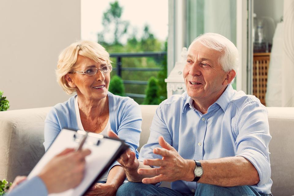 Senior couple sitting and talking