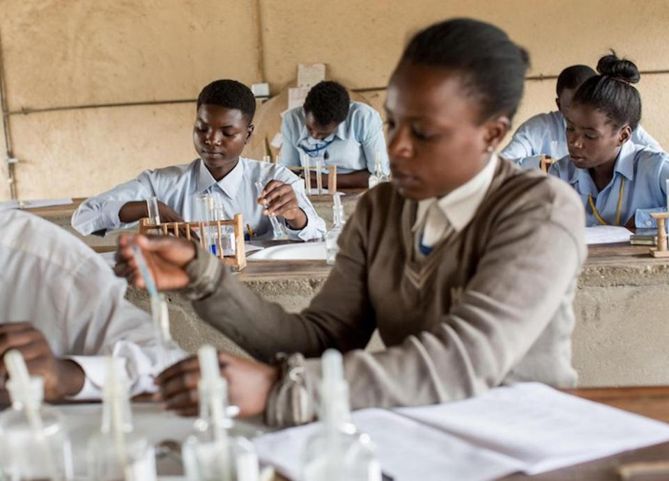 Adolescent girls conduct experiments during chemistry class at UNICEF-supported Kamulanga Secondary School in Lusaka, Zambia.