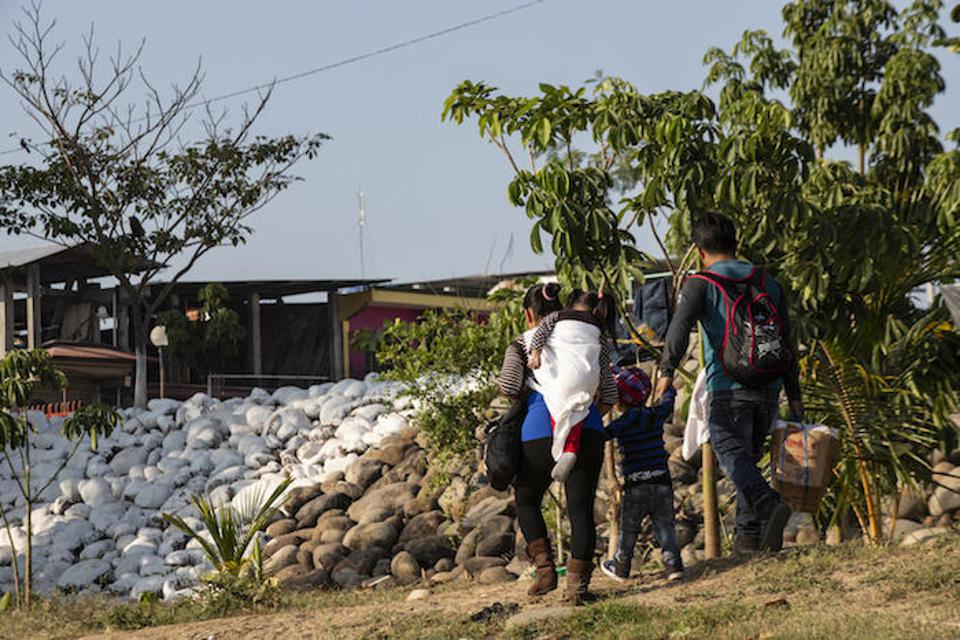 A family from Guatemala crosses into Mexico