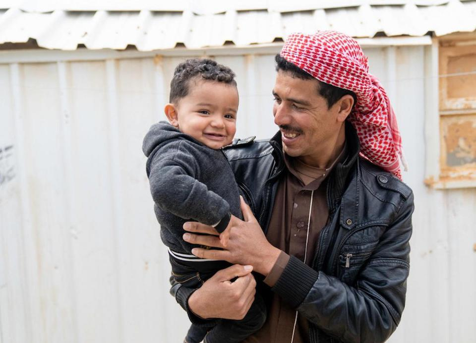 Syrian refugee Shaheen holds his 1-year-old son, Mohammad, in Jordan's Azraq refugee camp in 2019. Mohammad was born in the camp's UNICEF-supported pediatric hospital.