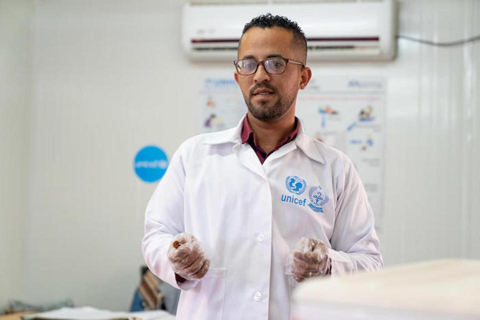Dr. Almanti, the Ministry of Health coordinator, has been vaccinating children in this UNICEF-supported health clinic in Azraq for five years.