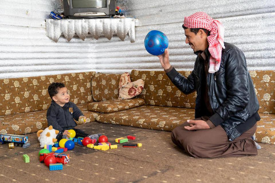 Mohammad loves playing with his father.