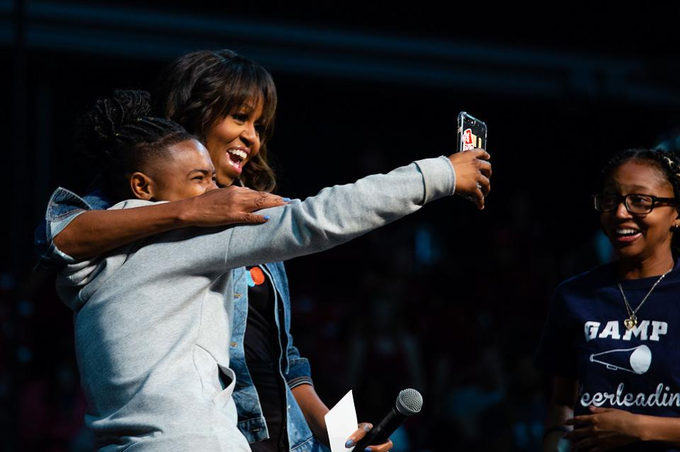 Michelle Obama takes a selfie with a student