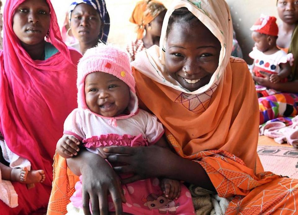 Mothers and children wait to receive lifesaving vaccinations at the UNICEF-supported health center in Ambatta, a suburb of Ndjamena, the capital of Chad, in 2019.