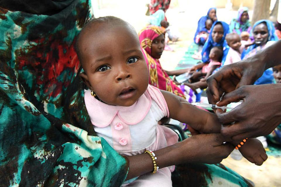 A baby is vaccinated at the UNICEF-supported health center in Bol, in central Chad, in 2019.
