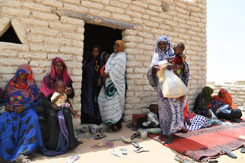 Women and children outside the UNICEF-supported health center in Bolingo, in central Chad, in 2019.