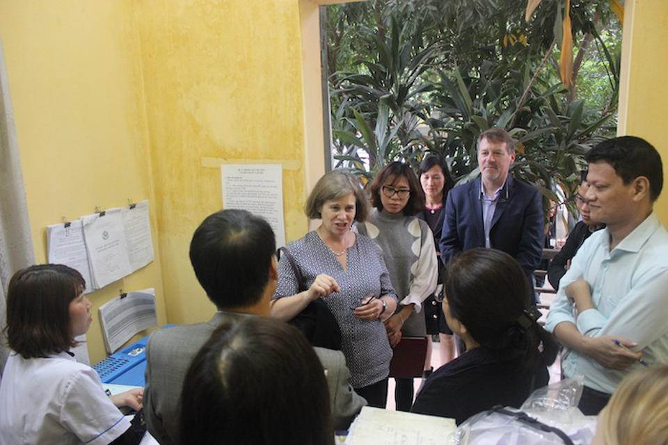 Violaine Mitchell, center, meets with community health workers in Vietnam.