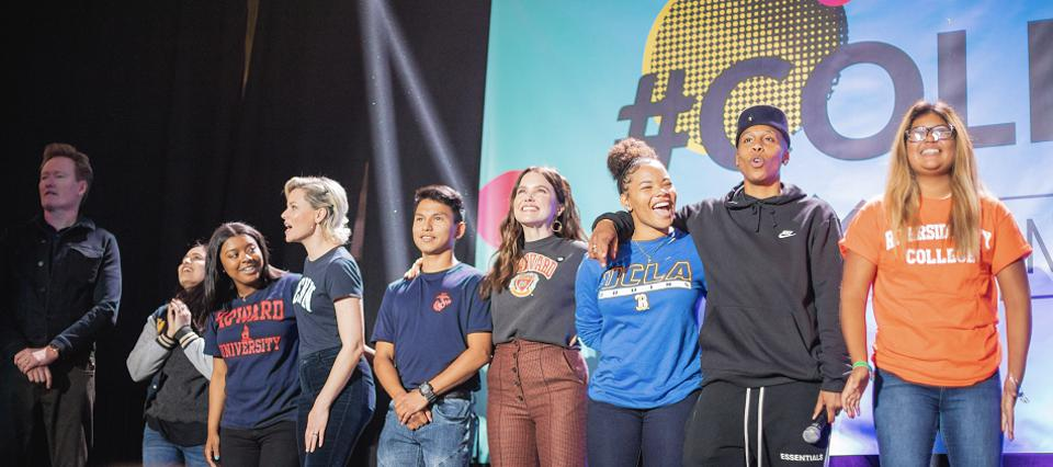 Students on stage with celebrities at College Signing Day