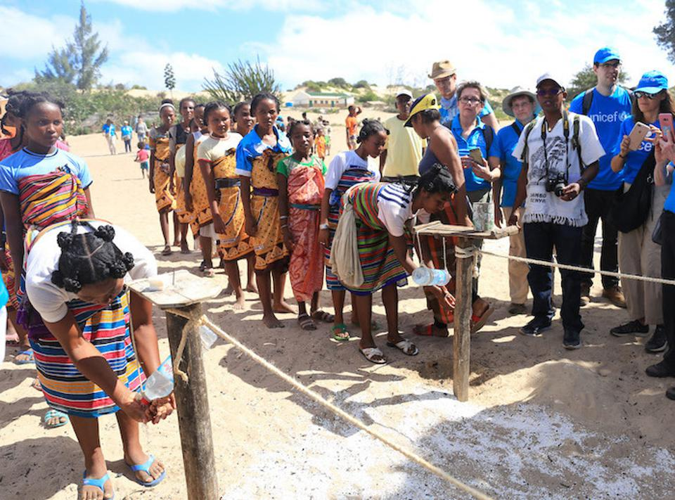 In Tanandava, Madagascar, Mother Leaders line up to wash their hands before a celebration welcoming a delegation from UNICEF USA and Zonta International.