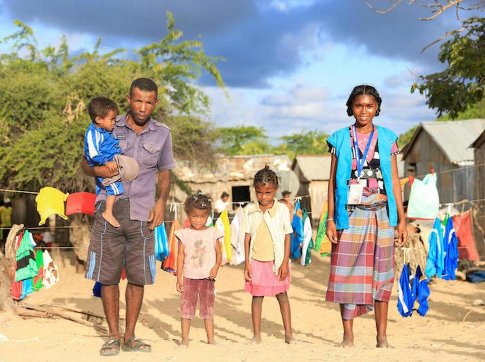 Zeme, 22, far right, pictured here with her family, works as a UNICEF-trained Mother Leader in Tanandava, Madagascar.