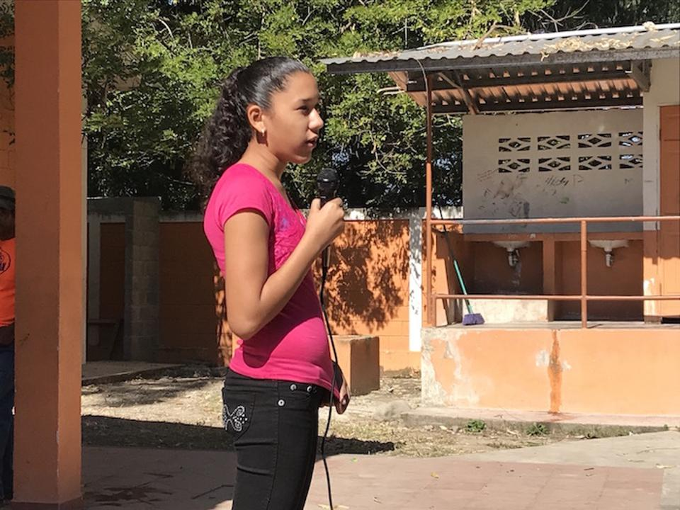 At a school assembly, the head of the student government at Miguel Paz Barahona School in La Ceiba, Honduras speaks out against violence.