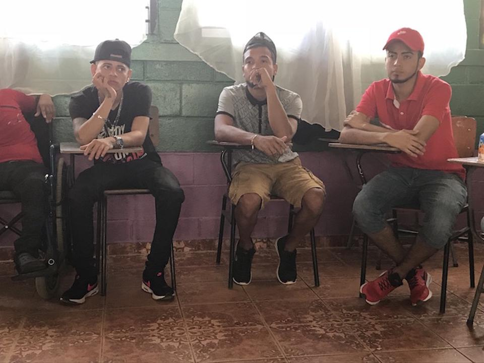 At a meeting at Escuela 3 Avril in Paujiles, in the municipality of El Progreso, Jorge, 21, center, says, ″All we want is a job opportunity in our country, but there are no jobs.