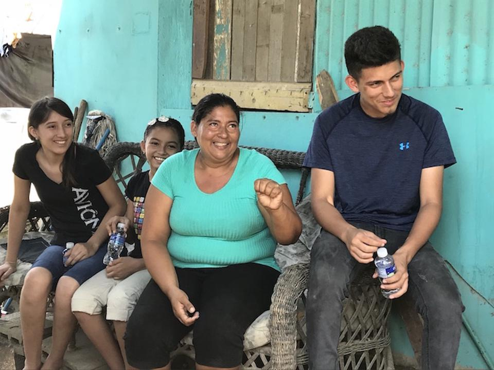 This mother (center) has migrated from her neighborhood of Pajuiles, near El Progreso, five times and suffered discrimination, deprivation and sexual attacks along the way.