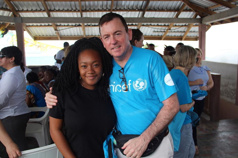 Andrea, pictured here with UNICEF Chief of Andrea, pictured here with UNICEF Chief of Development and Vice President Barron Segar, attended a community meeting in the seaside Corozal Village, where they discussed how UNICEF can help young people in the community.