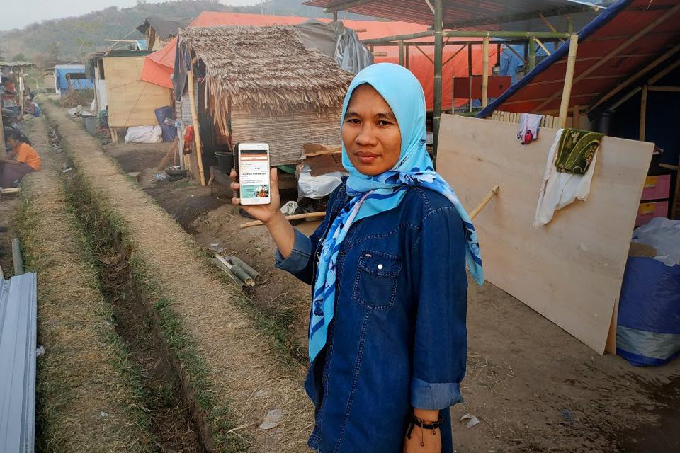 Siti Sanisah, an AtmaGo user and earthquake survivor in Lombok