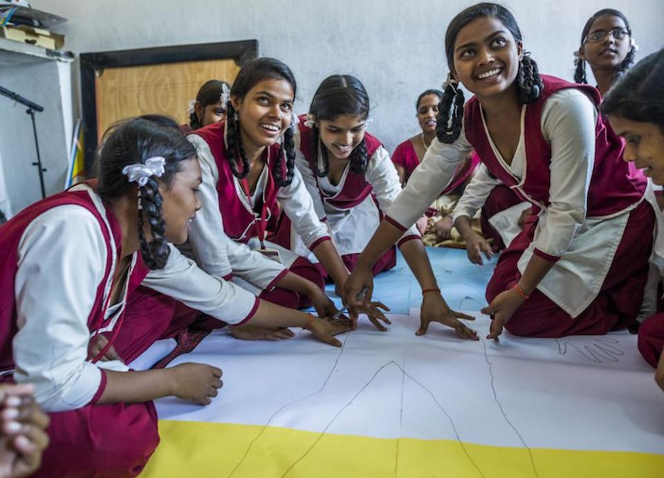 Adolescent girls in the Ramgarh district of Jharkhand state, India, participate in a body-mapping activity, part of a UNICEF-supported program to improve menstrual health and hygiene and help girls stay in school.