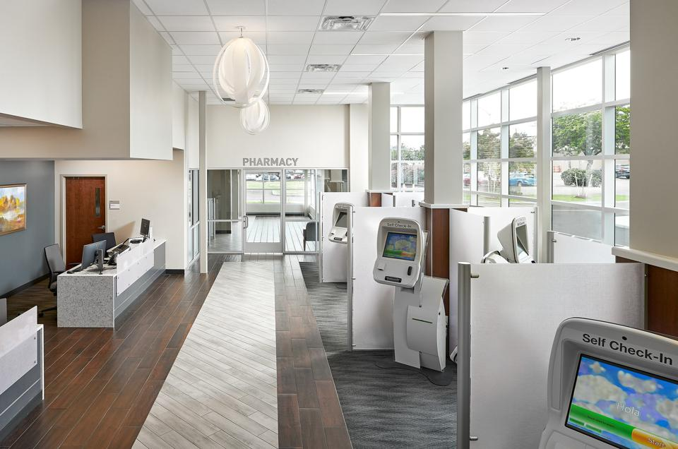 Lobby check-in area of Riedman Health Center with kiosks and natural lighting.