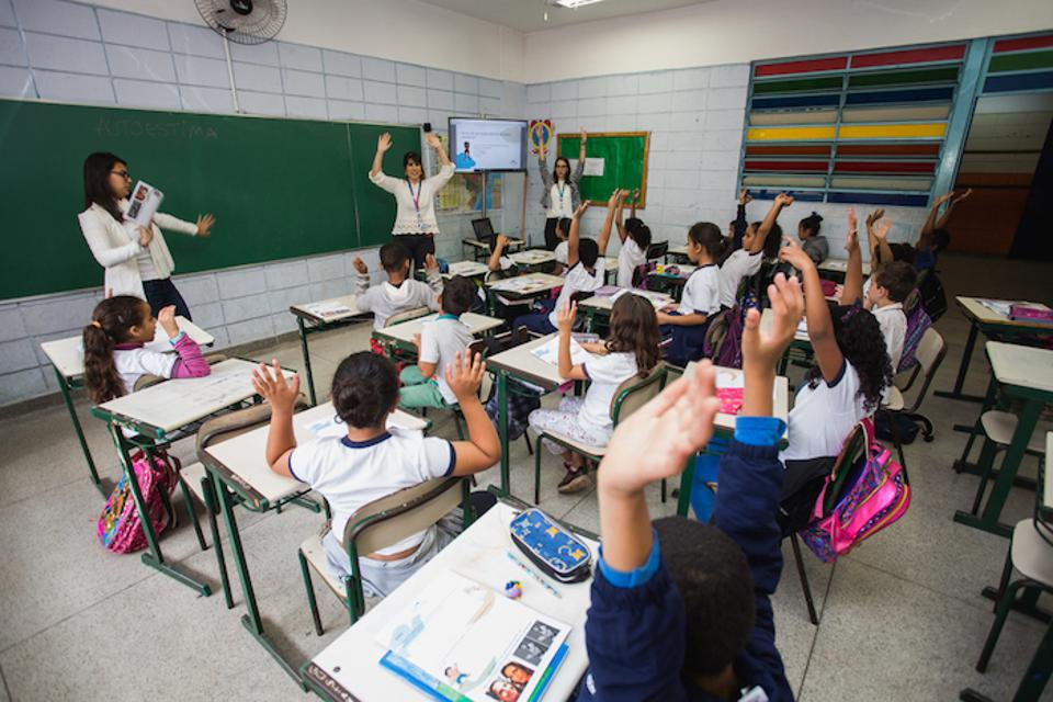 Self-esteem training encourages girls to be strong, adventurous and fearless. Above, Unilever employees discuss self-esteem and body confidence with a classroom of girls in Sao Paulo, Brazil.
