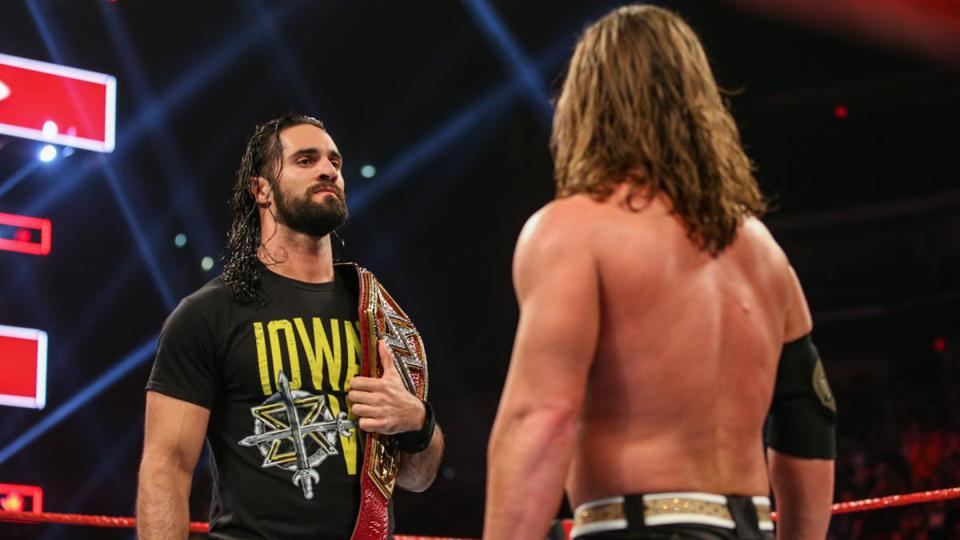 AJ Styles and Seth Rollins staredown