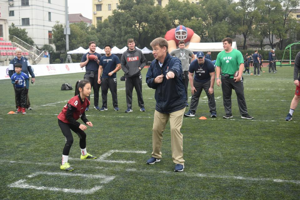 Young Chinese football players are becoming interested in American football.