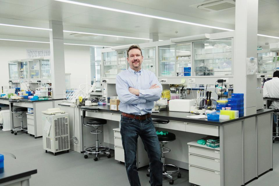 Patrick Reid, PeptiDream representative director and president, poses in a lab at company headquarters in	Kawasaki City.