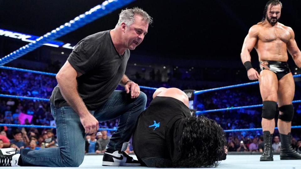 Shane McMahon attacks Roman Reigns