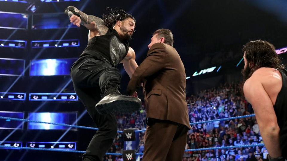 Roman Reigns punches Vince McMahon