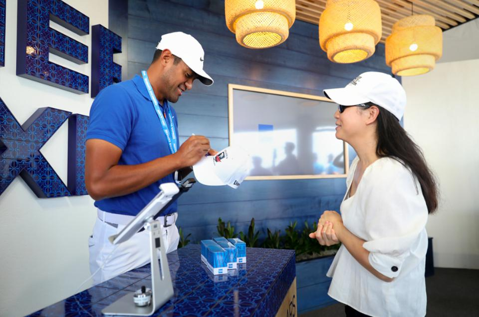 Tony Finau (left) surprises fans at Fan Services Hosted By American Express at the U.S. Open at Pebble Beach Golf Links on June 10, 2019 in Pebble Beach, California