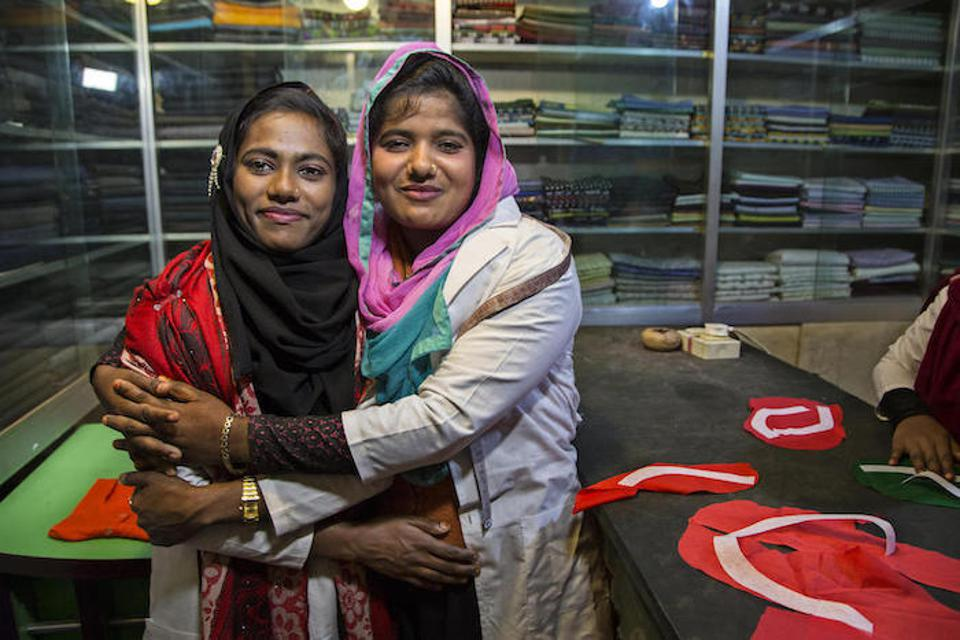 Jannatu, 17 (above left), and Rajia, 18, are training to become tailors at a shop in Ukhiya, Bangladesh.