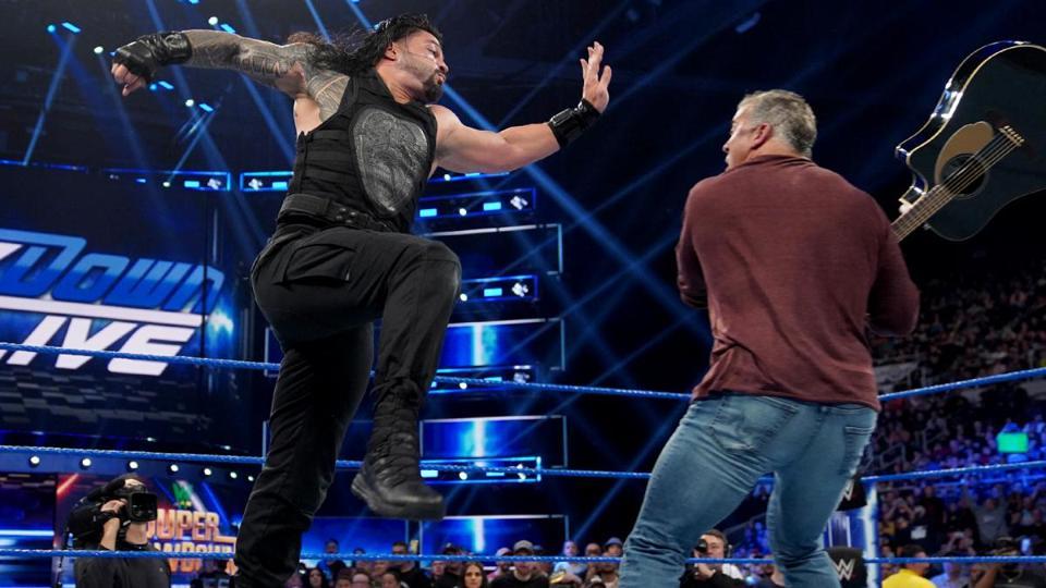 Roman Reigns punches Shane McMahon